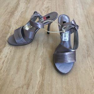 Women's high heeled silver sandals. Size 10